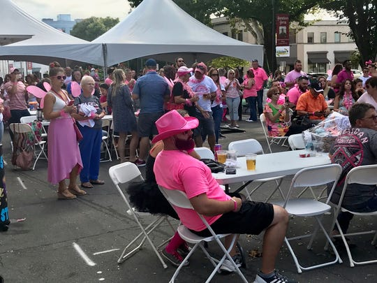 The 9th annual Lancaster Ohio Bra Crawl drew large crowd Saturday near the downtown bandstand at Broad and Main streets Saturday. The event raises money for one breast cancer survivor each years.