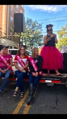 Mindy Bussart leads the 2019 Lancaster Ohio Bra Crawl Saturday near the downtown bandstand at Broad and Main streets as three previous Miss Bra Crawl winners look on.