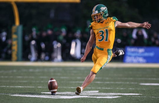 Floyd Central's Cole Hussung practiced some kicks from the 45-yard line before the game against New Albany Friday, Sept. 13, 2019