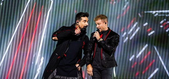 Kevin Richardson, left, and Brian Littrell of the Backstreet Boys perform at the KFC Yum! Center during their DNA World Tour stop in downtown Louisville. September 13, 2019