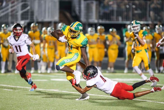 Floyd Central's Wenkers Wright had 350 yards rushing with five touchdowns in the Highlanders' 50-14 win over visiting New Albany Friday, Sept. 13, 2019.