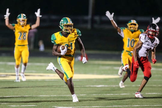 With his teammates already signaling a touchdown, Floyd Central's Wenkers Wright ran down the field for another score as he had 350 yards with five TDs as the Highlanders romped over 50-14 visiting New Albany Friday, Sept. 13, 2019.