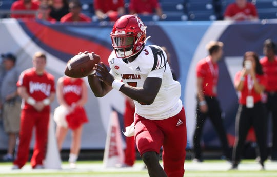 U of L QB Malik Cunningham (3) looks to pass against WKU during their game at Nissan Stadium in Nashville.