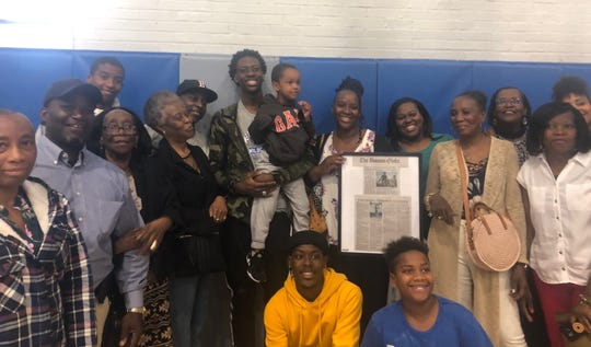 Terrence Clarke poses with his family after committing to play basketball at Kentucky.