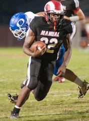 Manual running back Ja'Waun Northington breaks free of an Oldham County defender to score a touchdown. 13 September 2019