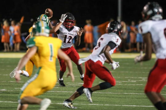 New Albany's Kyondre Winford passes under pressure from Floyd Central in the Bulldogs' loss to the Highlanders Friday, Sept. 13, 2019.