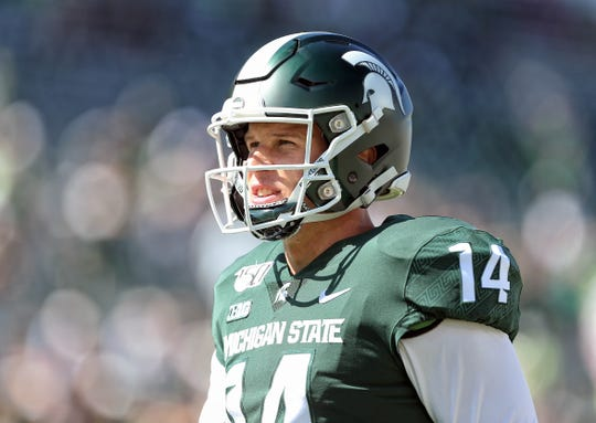 Sep 14, 2019; East Lansing, MI, USA; Michigan State Spartans quarterback Brian Lewerke (14) warms up prior to a game against the Arizona State Sun Devils at Spartan Stadium. Mandatory Credit: Mike Carter-USA TODAY Sports