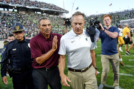 Michigan State's head coach Mark Dantonio, right, and Arizona State's head coach Herm Edwards meet on the field after the Spartans lost 10-7 on Saturday, Sept. 14, 2019, in East Lansing.