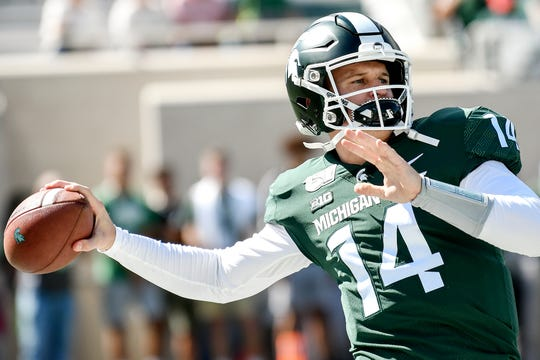 Quarterback Brian Lewerke warms up before the Spartans football game against Arizona State on Saturday, Sept. 14, 2019, in East Lansing.