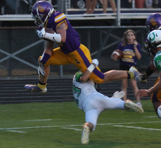 Lexington's Kaydan Berry goes airborne during a run against the Clear Fork Colts.
