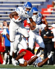 Memphis wide receiver Antonio Gibson leaps over South Alabama cornerback Gus Nave during their game Sept. 14.