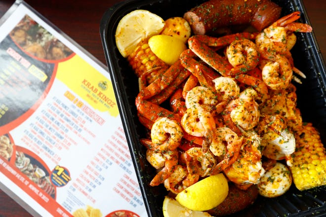 A loaded platter with snow crab, shrimp, sausauge, corn, eggs and potatoes at Krab Kingz in Bartlett on Thursday, Sept. 12, 2019.