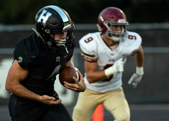 Houston running back Lincoln Pare (4) breaks a tackle and runs downfield for a 98 yard touchdown during the 1st quarter of a non-conference home game against Evangelical Christian School in Germantown, Tenn., on Friday, Sept. 13, 2019.