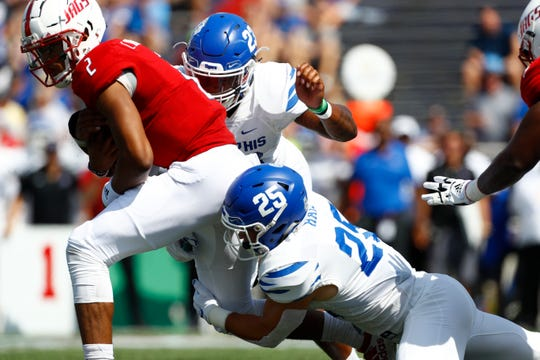 Memphis linebacker Austin Hall drags down South Alabama quarterback Cephus Johnson during their game at the Ladd-Peebles Stadium in Mobile, Ala. on Saturday, Sept. 14, 2019.