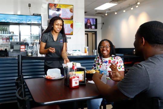 Marissa Blue serves Aspen Sanders and Trevor McCaster at Krab Kingz in Bartlett on Thursday, Sept. 12, 2019.