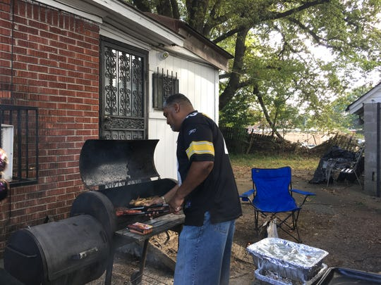 Sept. 14, 2019: James Sims cooks outside a family home on Raymond Street in Orange Mound during the parade for the Southern Heritage Classic.