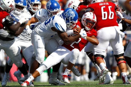Memphis defensive end Bryce Huff takes down South Alabama quarterback Cephus Johnson during their game at the Ladd-Peebles Stadium in Mobile, Ala. on Saturday, Sept. 14, 2019.