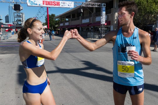 Women's first-place finisher Shaelyn  Sorensen and overall winner Erik Duethman congratulate each other after finishing the 42nd annual Briggs & Al's Run & Walk.