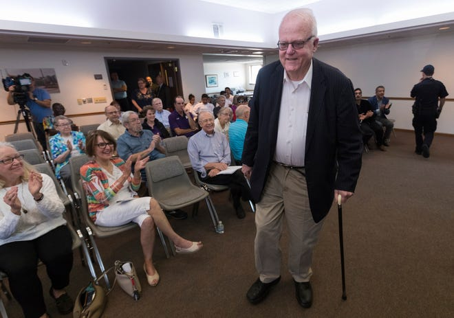 U.S. Rep. Jim Sensenbrenner, R-Wis., draws applause from some constituents as he kicks off a town hall listening session in the Town of Brookfield Saturday.
