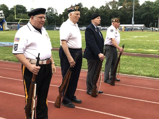 Members of local VFW and American Legion posts honor Butler High School alumni killed in action with a moment of silence and a 21-gun salute.