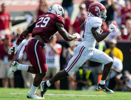 Alabama wide receiver Henry Ruggs, III, (11) breaks free for a long touchdown against South Carolina defensive back J.T. Ibe (29) at Williams-Brice Stadium in Columbia, S.C., on Saturday September 14, 2019.