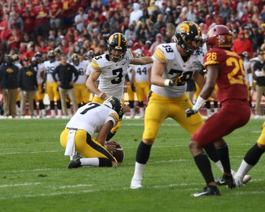 Sep 14, 2019; Ames, IA, USA; Iowa Hawkeyes place kicker Keith Duncan (3) kicks a field goal held by Colten Rastetter (7) in the first quarter against the Iowa State Cyclones at Jack Trice Stadium. Mandatory Credit: Reese Strickland-USA TODAY Sports