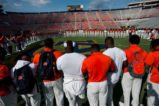 Auburn players gather for a prayer before the game at Jordan-Hare Stadium in Auburn, Ala., on Saturday, Sept. 14, 2019.