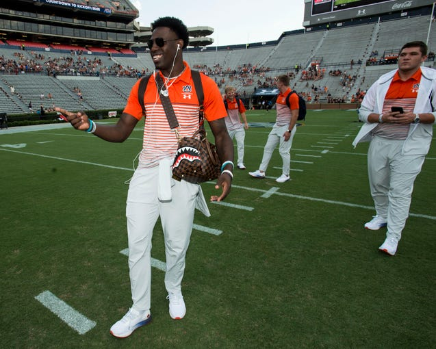 Auburn defensive back Smoke Monday (21) walks the field after Tiger Walk at Jordan-Hare Stadium in Auburn, Ala., on Saturday, Sept. 14, 2019.