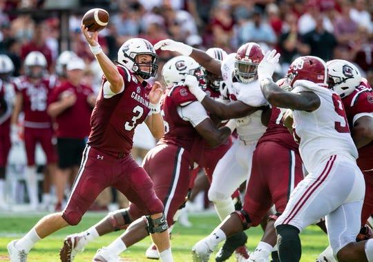 South Carolina quarterback Ryan Hilinski (3) throws under pressure against Alabama at Williams-Brice Stadium in Columbia, S.C., on Saturday September 14, 2019.
