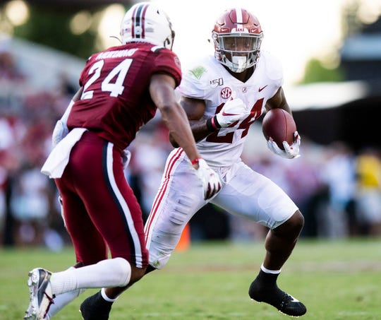 Alabama running back Brian Robinson, Jr., (24) runs against South Carolina defensive back Israel Mukuamu (24) at Williams-Brice Stadium in Columbia, S.C., on Saturday September 14, 2019.
