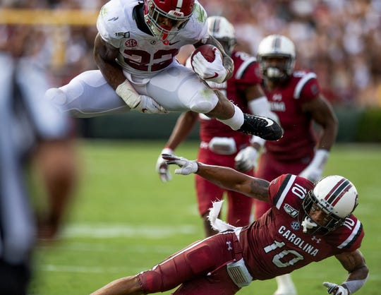 Alabama running back Najee Harris (22) hurdles South Carolina defensive back R.J. Roderick (10) on his way to a touchdown at Williams-Brice Stadium in Columbia, S.C., on Saturday September 14, 2019.