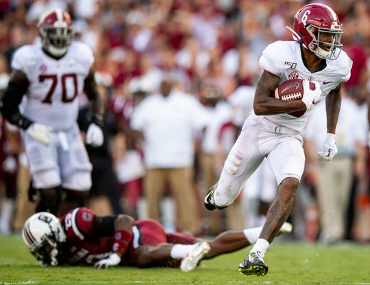 Alabama wide receiver DeVonta Smith (6) scores a long touchdown against South Carolina at Williams-Brice Stadium in Columbia, S.C., on Saturday September 14, 2019.