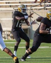 ASU quarterback KHA'Darris Davis (12) takes a snap during the first quarter.