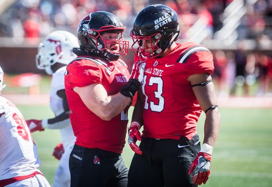FILE -- Ball State linebackers Jacob White (left) and Jordan Williams (right) celebrate after a play against Florida Atlantic during a game at Scheumann Stadium on Sept. 14, 2019.