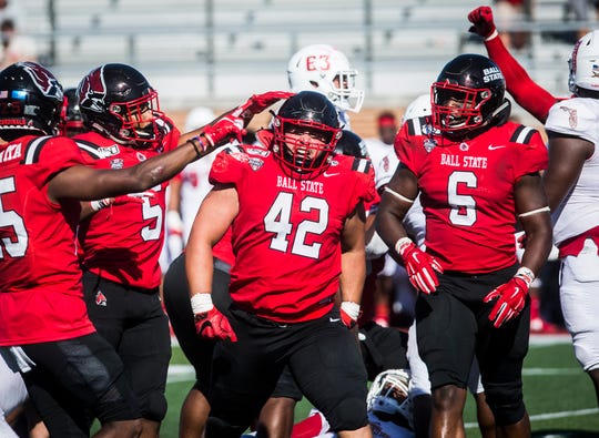 Ball State's Chris Crumb celebrates a sack against Florida Atlantic during their game at Scheumann Stadium Saturday, Sept. 14, 2019.