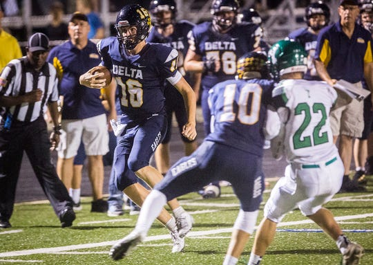 Delta's Brady Hunt runs down the sideline during the game against Yorktown at Delta High School Friday, Sept. 13, 2019.
