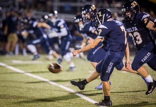 Delta kicker Zac Stanley kicks a ball off during a game against Yorktown at Delta High School on Sept. 13, 2019.