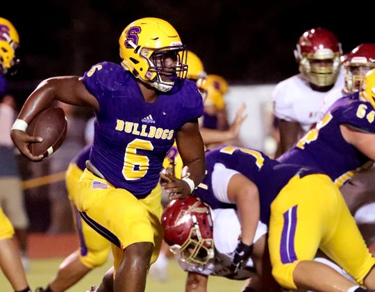 Smyrna's Mikel Hartfield (6) runs the ball during the game against Riverdale at Smyrna on Friday Sept. 13, 2019.