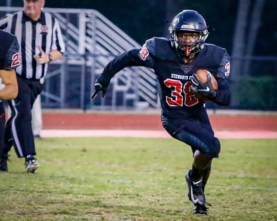 Stewarts Creek running back Amari Jelks eclipsed the 1,000 rushing yard mark this season in the Red Hawks' 42-6 win over Station Camp.