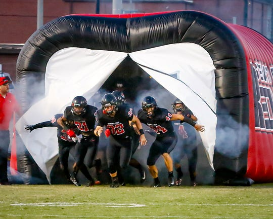 Stewarts Creek players enter the field prior to a recent game. The Red Hawks play at Smyrna Friday.