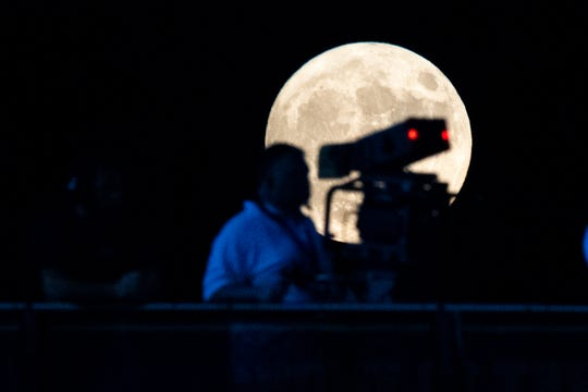 The Harvest Moon rises over Ravenwood High School during the first half between Ravenwood and Pulaski Academy in Brentwood, Tenn., Friday, Sept. 13, 2019.