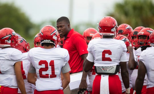 Immokalee head coach Rodelin Anthony talks with his team before the game against Barron Collier at Barron Collier High Friday night, September 13, 2019.