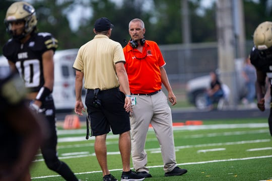 Golden Gate High School football coach Nick Bigica, left, shakes hands with Lely High School coach JJ Everage, before their game, Friday, Sept. 13, 2019, at Titan Stadium.