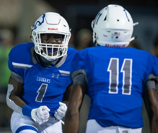 Deshaun Duverge of Barron Collier celebrates scoring a touchdown Jaheim Arnold during the game against Immokalee at Barron Collier High Friday night, September 13, 2019.