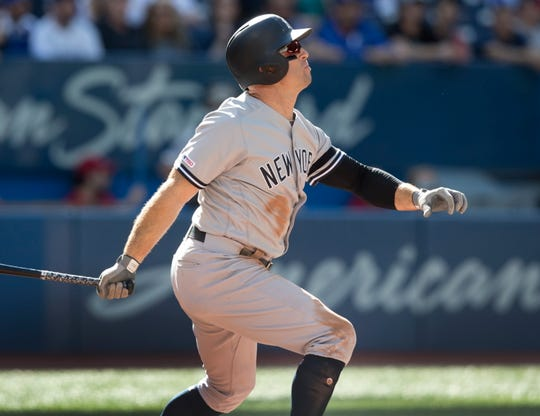 New York Yankees' Brett Gardner hits a home run against the Toronto Blue Jays in the fourth inning of a baseball game in Toronto, Saturday, Sept. 14, 2019.