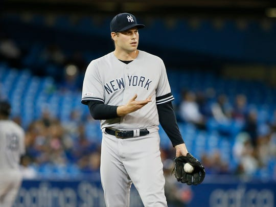 Sep 13, 2019; Toronto, Ontario, CAN; New York Yankees pitcher Adam Ottavino (0) reacts after being called for a balk allowing the Toronto Blue Jays to score a run during the seventh inning at Rogers Centre.