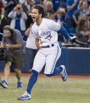 Toronto Blue Jays designated hitter Bo Bichette rounds the bases after hitting a walkoff home run to defeat the New York Yankees in the 12th inning of a game in Toronto, Friday, Sept. 13, 2019.