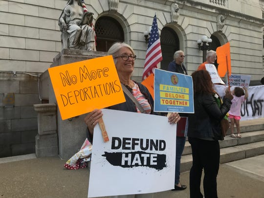 "Lorna Henkel of Secaucus joins advocates gathered in Hackensack to call for Congress to cut funding to immigration enforcement agencies on September 13, 2019 as part of a ""Defund Hate"" national campaign."