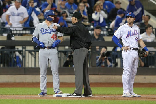Sep 13, 2019; New York City, NY, USA; Third base umpire Dan Iassogna (58) tells Los Angeles Dodgers second baseman Gavin Lux (48) to score after hitting a three-run home run against the New York Mets during the fourth inning at Citi Field. The play was reviewed and ruled a home run.