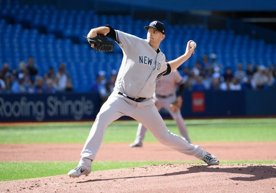 Sep 14, 2019; Toronto, Ontario, CAN; New York Yankees starting pitcher James Paxton (65) throws a pitch during the first inning against the Toronto Blue Jays at Rogers Centre.